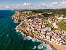 Aerial View Of Praia Das Macas Little Township Along South Portuguese Coastline Facing The Atlantic Ocean, Colares, Portugal.