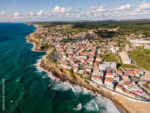 Canvas Print Aerial view of Praia das Macas little township along south Portuguese coastline facing the Atlantic Ocean, Colares, Portugal