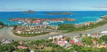 Panoramic Aerial View Of Victoria, Eden Island And The St. Anne Marine National Park On The East Coast Of Mahé, Seychelles.