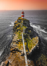 Aerial View Of Mayak Na Myse Basargina, A Lighthouse On The Rocky Promontory Facing The Bay At Sunrise In Vladivostok, Russia.