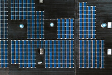 Aerial Top Down View Of Solar Energy Panels Park On A Factory Rooftop Collecting Green Energy From Sun In Kaunas, Lithuania.
