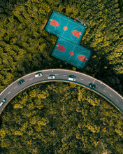 Aerial View Of Two Tennis Courts Along The Highway Crossing The Wood, Shanghai, China.