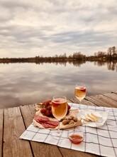 Breakfast On Table By Lake Against Sky