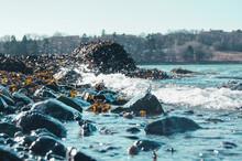 Waves Hitting Rocks In Ocean.