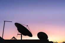 Low Angle View Of Silhouette Dish Antenna Against Sky During Sunset