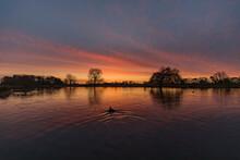 Sunrise Reflections Over Lake