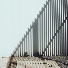 Surface Level Of Metal Fence Against Clear Sky
