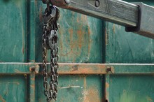 Close-up Of Metallic Chain Hanging Outdoors