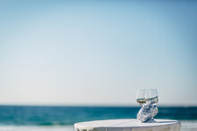View Of Drinks On Table Against Sea