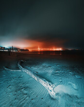 Scenic View Of Beach With Driftwood Against Sky During Night