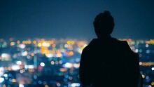 Rear View Of Silhouette Man Standing Against Sky At Night