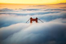 Golden Gate Bridge Peak During Fog Season Against Sky During Sunset
