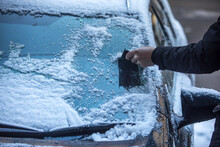 Midsection Of Person In Car During Winter