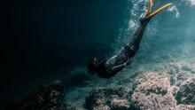 Full Length Of Woman Diving Undersea