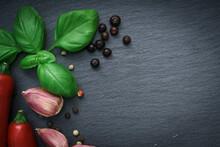Chilli Pepper, Dry Pepper,  Garlic On Slate Black Stone Plate.