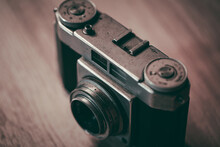 Old Vintage Camera Placed On A Blurred Background.