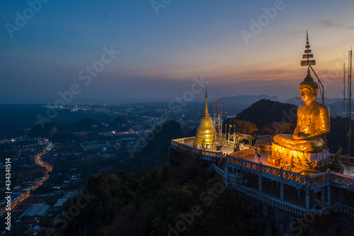 Obraz na płótnie Aerial view from drone of Wat Tham Suea (The Tiger Cave temple) during sunset well-known temple on a hilltop in Krabi, Thailand