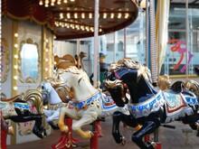 View Of Carousel Horses In Amusement Park