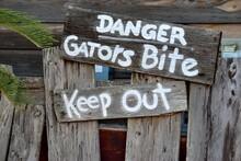 Danger Gators Bite Warning Sign Background