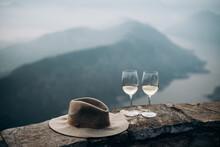 Wine Glass On Rock Against Mountain Range