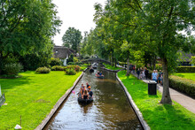 Giethoorn, Netherlands - 13 September 2020. Tourists Sailing On Rented Boats On The Canal.