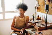 Woman Sitting In Ornament Workshop