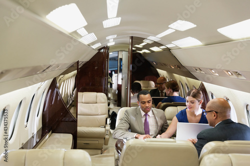 Tela Business people working in private jet