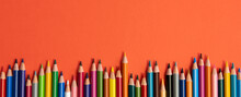 Colored Pencils Isolated On Red Background Close Up Concept With Copy Space For Text