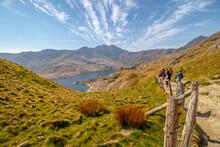 Snowdonia,Wales, UK. Tourist Hiking At Snowdon Mountain Landscape. Snowdon Mountain Landscape Is Located In Snowdonia National Park,Wales, United Kingdom.
