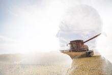 Digital Composite Pensive Businessman Watching Combine Harvester