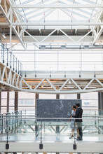 Business People At Blackboard With Complex Equations Atrium