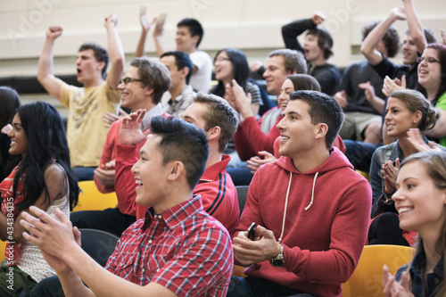 Canvas Print Large group of students cheering at college sporting event