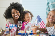 Happy Mother And Daughter Celebrating Fourth Of July At Home