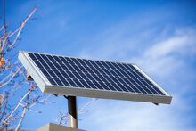 Closeup Shot Of A Solar Panel Under A Blue Sky