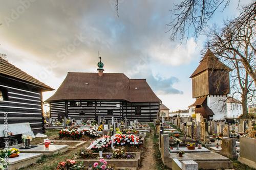 Obraz na plátně Old cemetery and wooden Church of St