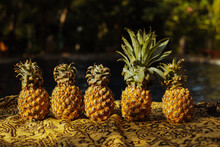 Close-up Of Pineapple Fruits On Table