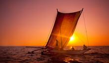 Fishermen On A Catamaran At Sunset. Sri Lanka