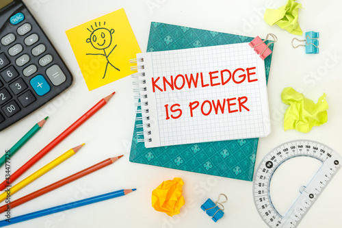 Notebook with school supplies and the inscription KNOWLEDGE IS POWER