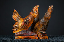 Figurines Of Wood Grouse And Black Grouse Birds Carved From Wood. Old Wooden Crafts On A Dark Background.