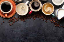 Many Cups Of Coffee On Stone Table