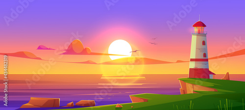 Foto Lighthouse on sea shore at sunset, beacon building at scenery dusk view, nature ocean landscape with rocky coast under cloudy sky with flying gulls