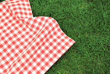 000Red Picnic  Towel On Green Grass Top View, Checked Cloth Flat Lay. Food Advertisement Display.