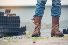 Men Wear Construction Boots Safety Footwear For Worker At Construction Site. Engineer Wear Jeans Brown Boots Worker On Background Of Refinery. Engineer Safety Industry Fashion Footwear Walking Outdoor