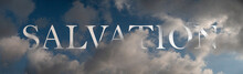 Abstract Religious Concept. Salvation In The Air. Symbolic Word Inscibed Amongst Clouds On A Dark Blue Sky.