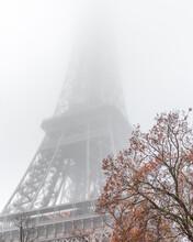 Eiffel Tower Shrouded By Fog In A Parisian Winter