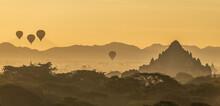 Hot Air Ballon Cluster Over Dhammayan Gyi Temple In Bagan, Myanmar At Sunrise.