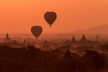 Hot Air Balloons Fly Over Temples Of Bagan, Myanmar At Sunrise.