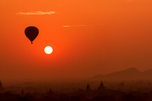 Hot Air Balloon Close To The Sun Over Temples Of Bagan, Myanmar At Sunrise.
