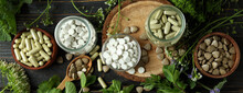 Concept Of Herbal Medicine Pills On Wooden Table, Top View