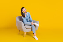 Full Length Body Size Photo Woman Sitting In Chair Looking Blank Space Dreamy Wearing Glasses Isolated Vibrant Yellow Color Background